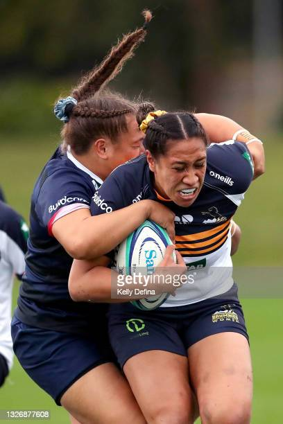 Siokapesi Palu of the Brumbies runs with the ball while being tackled Ashley Marsters of the Rebels during the Super W match between the Melbourne...