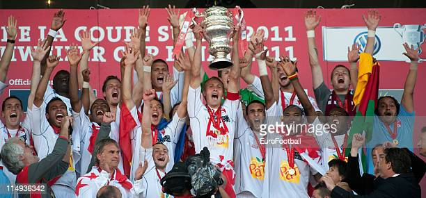 Sion players celebrate with the trophy after the Swiss Cup final match between Neuchatel Xamax FC and FC Sion at the Sankt Jakob Stadium on May 29,...