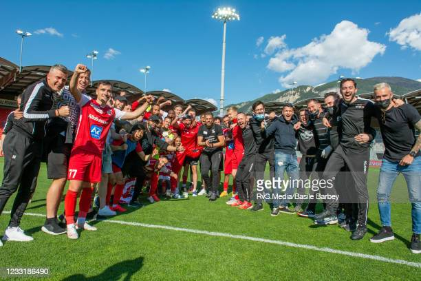 Sion team celebrate staying in Super League after the Super League Barrage game between FC Sion and FC Thun at Stade Tourbillon on May 30, 2021 in...
