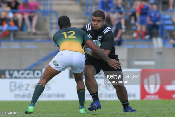 Sione Asi of New Zealand is tackled by Lyle Hendricks of South Africa during World Rugby Under 20 Championship 3rd Place Play 0ff between South...