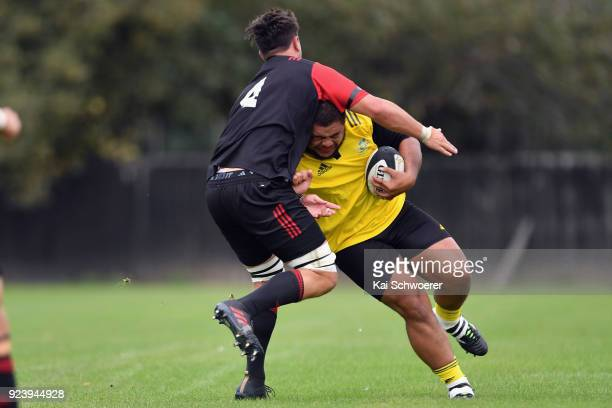 Sione Asi of the Hurricanes is tackled by Quinten Strange of the Crusaders Knights during the match between the Crusaders Knights and the Hurricanes...