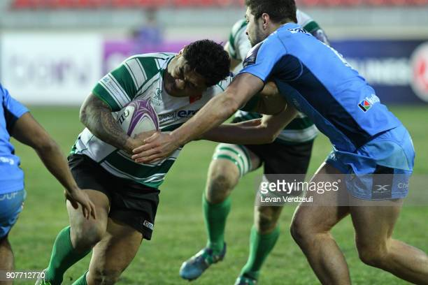 Sione Fukofuka of Krasny Yar is tackled during the European Rugby Challenge Cup match between Krasny Yar and London Irish at Avchala Stadium on...