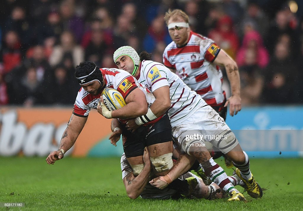 Sione Kalamafoni of Gloucester Rugby is tackled by Blair Cowan of London Irish during the Aviva Premiership match between Gloucester Rugby and London Irish at Kingsholm Stadium on January 2, 2016 in Gloucester, England. (Photo by Tom Dulat/Getty Images).
