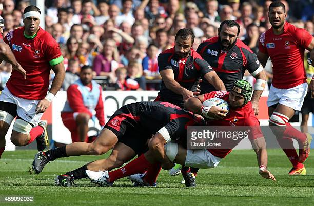 Sione Kalamafoni of Tonga is tackled by Tamaz Mchedlidze of Georgia during the Group C Rugby World Cup match between Tonga and Georgia at Kingsholm...