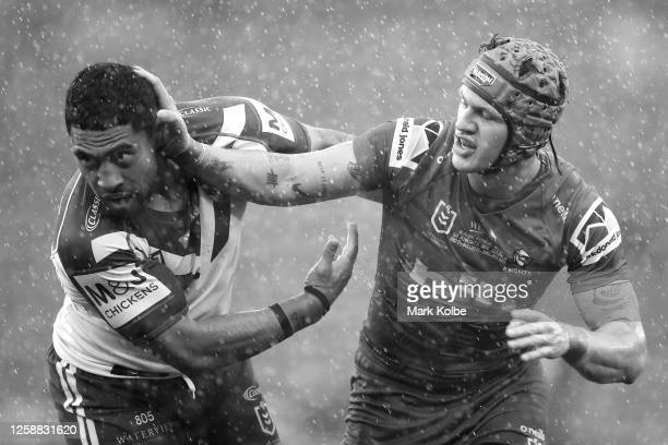 Sione Katoa of the Bulldogs and Kalyn Ponga of the Knights wrestle during the round 11 NRL match between the Newcastle Knights and the Canterbury...