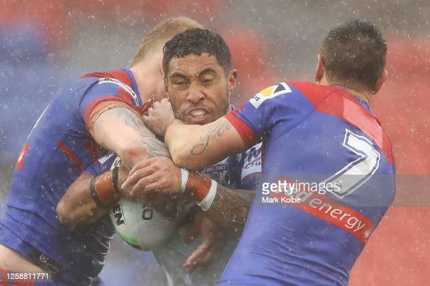 Sione Katoa of the Bulldogs is tackled during the round 11 NRL match between the Newcastle Knights and the Canterbury Bulldogs at McDonald Jones...