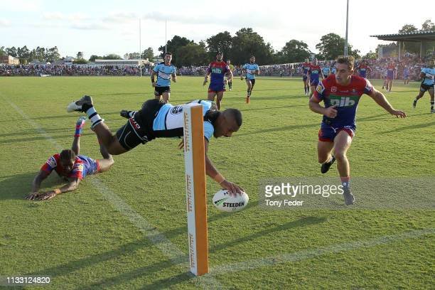 Sione Katoa of the Cronulla Sharks scores a try during the NRL Trial match between the Cronulla Sharks and the Newcastle Knights on March 02, 2019 in...