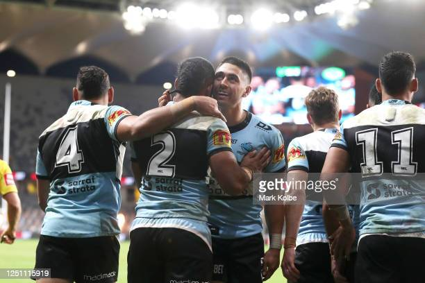 Sione Katoa of the Sharks celebrates with Shaun Johnson of the Sharks after scoring a try during the round six NRL match between the Cronulla Sharks...