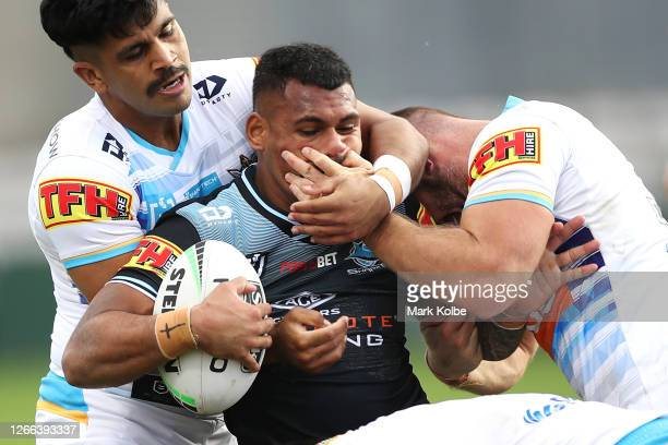 Sione Katoa of the Sharks is tackled during the round 14 NRL match between the Cronulla Sharks and the Gold Coast Titans at Netstrata Jubilee Stadium...