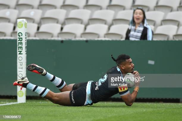 Sione Katoa of the Sharks scores a try during the round 14 NRL match between the Cronulla Sharks and the Gold Coast Titans at Netstrata Jubilee...
