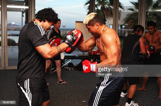 Sione Lauaki and Jerry Collins of the New Zealand All Blacks take part in an early morning workout at the team hotel on September 04 prior to...