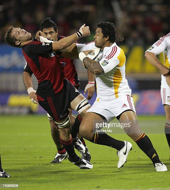 Sione Lauaki of the Chiefs fends off Richie McCaw of the Crusaders during the round 14 Super 14 match between the Crusaders and the Chiefs at Jade...
