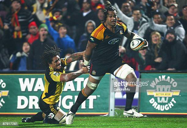 Sione Lauaki of the Chiefs fends off Rodney So'oialo of the Hurricanes during the first semi final Super 14 match between the Chiefs and the...