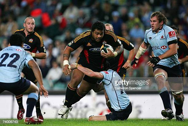 Sione Lauaki of the Chiefs is tackled during the round 13 Super 14 match between the Waratahs and the Chiefs at Aussie Stadium on April 27 2007 in...