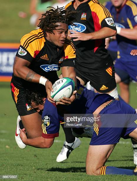 Sione Lauaki of the Chiefs tackled by Jason Kawau during the Highlanders versus Chiefs Super 14 preseason rugby match played at the Events Centre on...