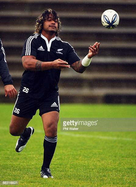 Sione Lauaku offloads the ball during a Junior All Blacks training session at Unitec on June 9 2009 in Auckland New Zealand