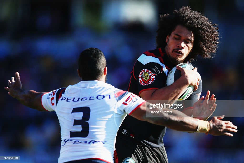 Sione Lousi of the Warriors charges forward during the round 24 NRL match between the New Zealand Warriors and the Sydney Roosters at Mt Smart Stadium on August 24, 2014 in Auckland, New Zealand.