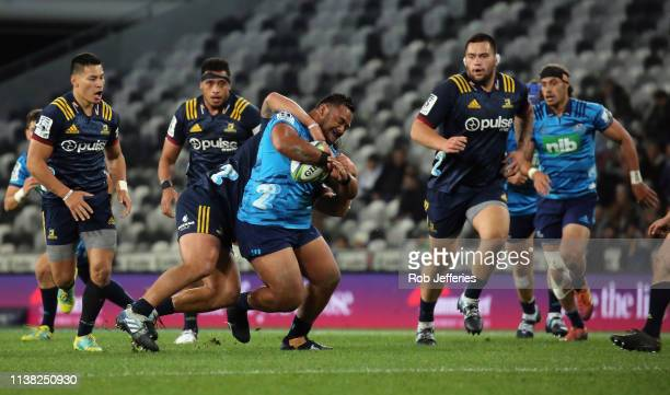 Sione Mafileo of the Blues is tackled during the round 10 Super Rugby match between the Highlanders and the Blues at Forsyth Barr Stadium on April 20...