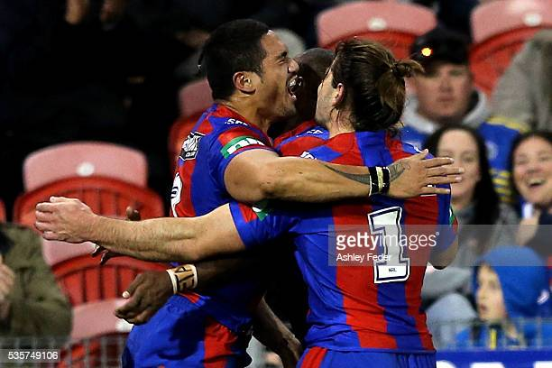 Sione Mata'utia of the Knights celebrates his try with Jake Mamo during the round 12 NRL match between the Newcastle Knights and the Parramatta Eels...