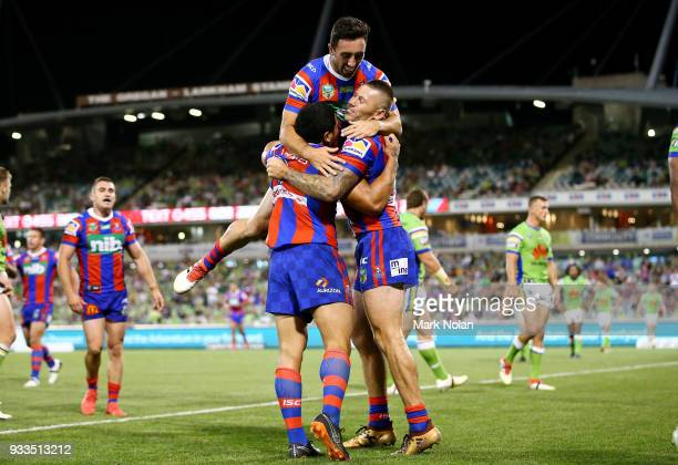 Sione Mata'utia of the Knights celebrates scoring a try with team mates during the round two NRL match between the Canberra Raiders and the Newcastle...