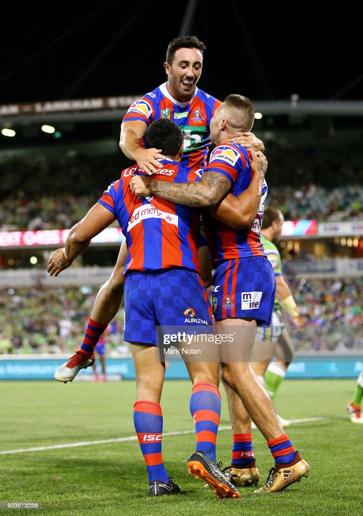 Sione Mata'utia of the Knights celebrates scoring a try with team mates during the round two NRL match between the Canberra Raiders and the Newcastle Knights at GIO Stadium on March 18, 2018 in Canberra, Australia.