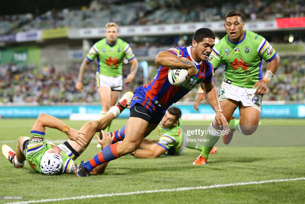 Sione Mata'utia of the Knights heads to the try line to score during the round two NRL match between the Canberra Raiders and the Newcastle Knights at GIO Stadium on March 18, 2018 in Canberra, Australia.