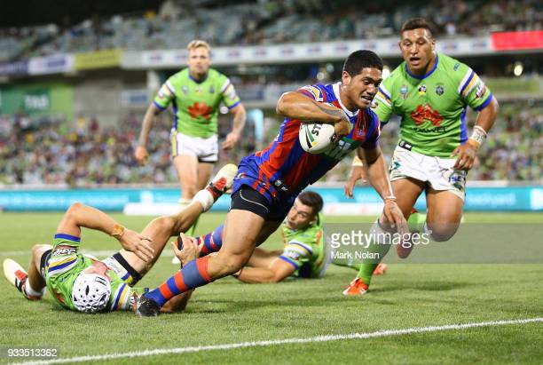Sione Mata'utia of the Knights heads to the try line to score during the round two NRL match between the Canberra Raiders and the Newcastle Knights...