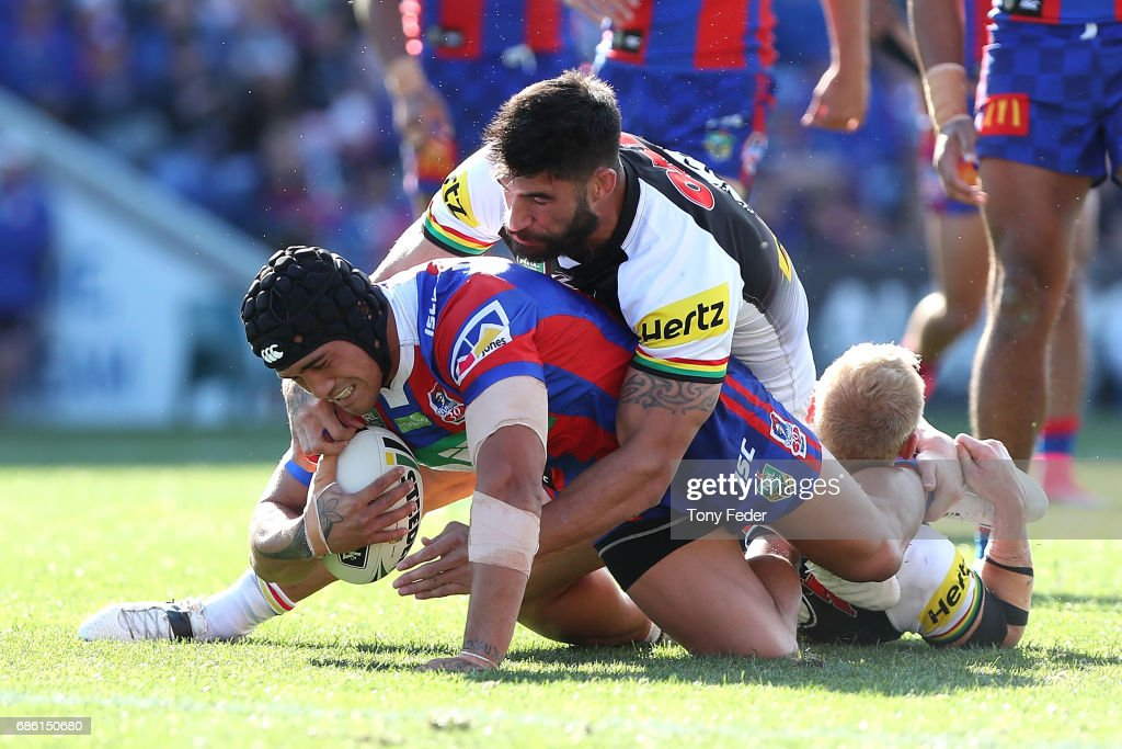Sione Mata'Utia of the Knights is tackled by James Tamou of the Panthers during the round 11 NRL match between the Newcastle Knights and the Penrith Panthers at McDonald Jones Stadium on May 21, 2017 in Newcastle, Australia.
