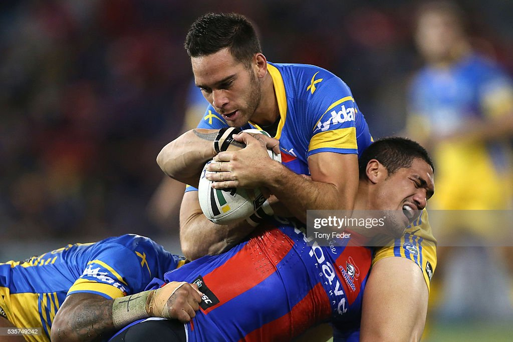 Sione Mata'Utia of the Knights is tackled by the Eels defence during the round 12 NRL match between the Newcastle Knights and the Parramatta Eels at Hunter Stadium on May 30, 2016 in Newcastle, Australia.