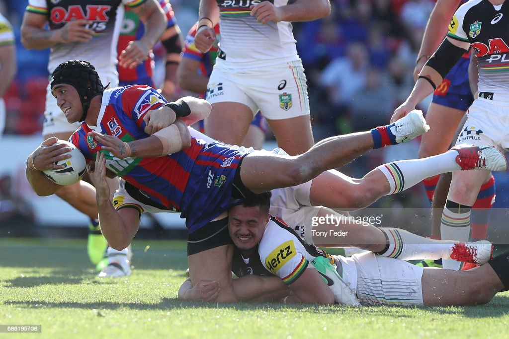 Sione Mata'Utia of the Knights is tackled by the Panthers defence during the round 11 NRL match between the Newcastle Knights and the Penrith Panthers at McDonald Jones Stadium on May 21, 2017 in Newcastle, Australia.