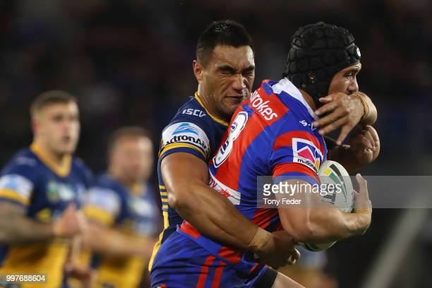Sione Mata'utia of the Knights is tackled during the round 18 NRL match between the Newcastle Knights and the Parramatta Eels at McDonald Jones...