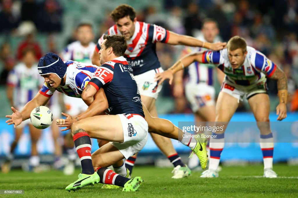 Sione Mata'utia of the Knights is tackled during the round 20 NRL match between the Sydney Roosters and the Newcastle Knights at Allianz Stadium on July 21, 2017 in Sydney, Australia.