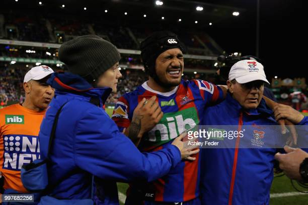 Sione Mata'Utia of the Knights is walked off for an injury during the round 18 NRL match between the Newcastle Knights and the Parramatta Eels at...