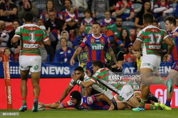 Sione Mata'Utia of the Knights scores a try during the round nine NRL match between the Newcastle Knights and the South Sydney Rabbitohs at McDonald...