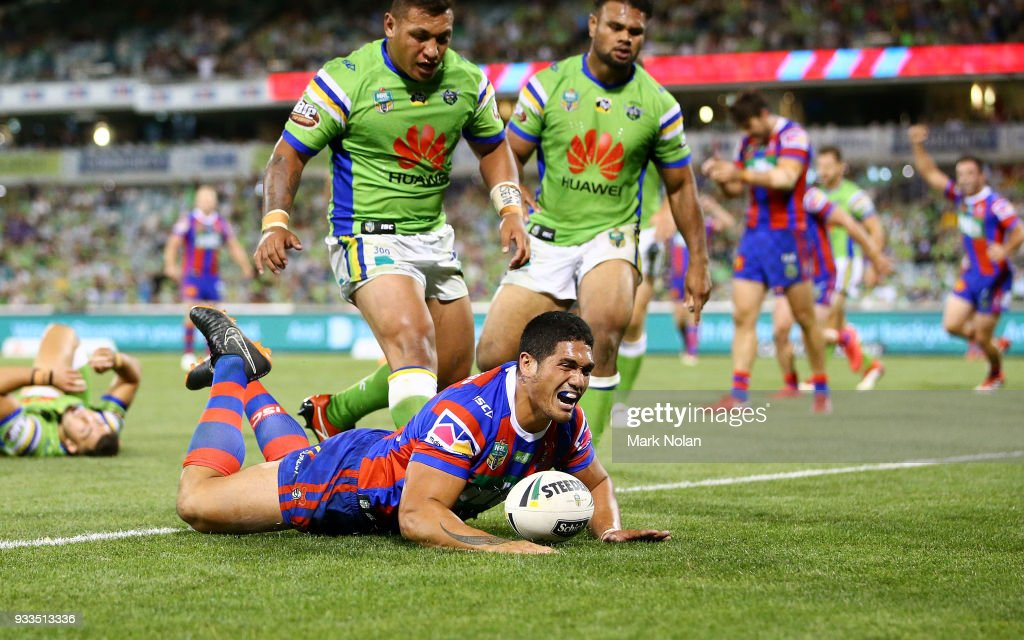 Sione Mata'utia of the Knights scores a try with team mates during the round two NRL match between the Canberra Raiders and the Newcastle Knights at GIO Stadium on March 18, 2018 in Canberra, Australia.