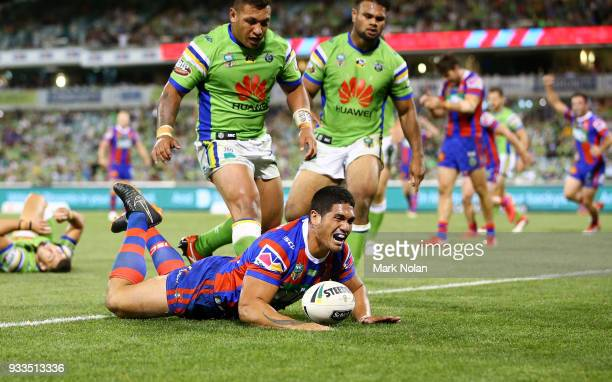 Sione Mata'utia of the Knights scores a try with team mates during the round two NRL match between the Canberra Raiders and the Newcastle Knights at...