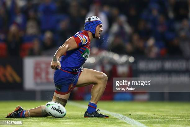 Sione Mata'Utia of the Newcastle Knights celebrates his try during the round 16 NRL match between the Newcastle Knights and the New Zealand Warriors...