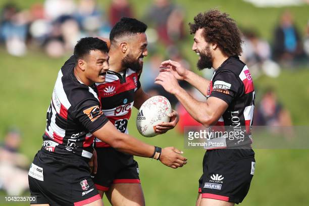 Sione Molia of Counties Manukau celebrates after scoring a try with Liam Daniela and Orbyn Leger of Counties Manukau during the round seven Mitre 10...