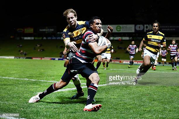 Sione Molia of Counties Manukau is tackled by Marty McKenzie of Taranaki as he goes for a try during the round five Mitre 10 Cup match between...