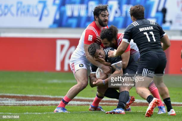 Sione Molia of New Zealand is tackled by Jonathan Laugel of France during the HSBC Paris sevens match between Samoa and South Africa on May 14 2017...