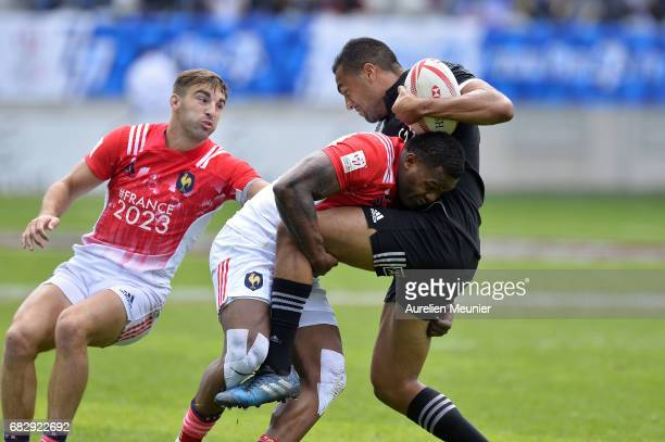 Sione Molia of New Zealand is tackled by Virimi Watakawa of France during the HSBC Paris sevens match between Samoa and South Africa on May 14 2017...