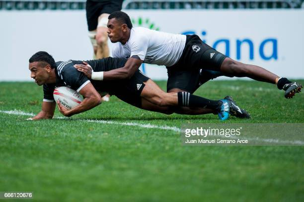 Sione Molia of New Zealand is tackled during the 2017 Hong Kong Sevens match between Fiji and New Zealand at Hong Kong Stadium on April 8 2017 in...