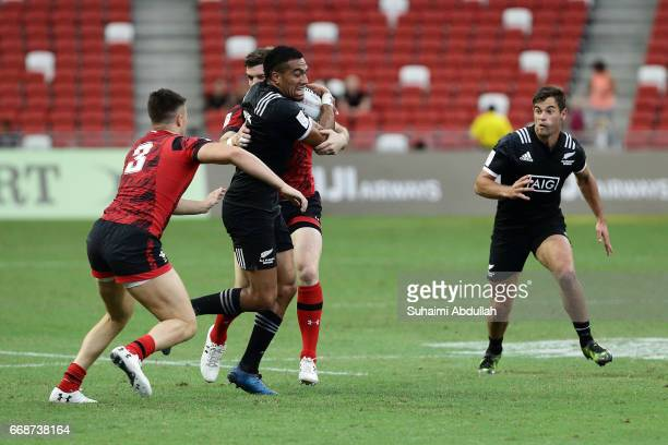 Sione Molia of New Zealand is tackled during the 2017 Singapore Sevens match between New Zealand and Wales at National Stadium on April 15 2017 in...