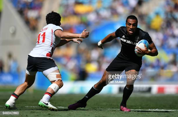 Sione Molia of New Zealand takes on Ethan Waddleton of England during the Rugby Sevens Men's SemiFinal between England and New Zealand on day 11 of...