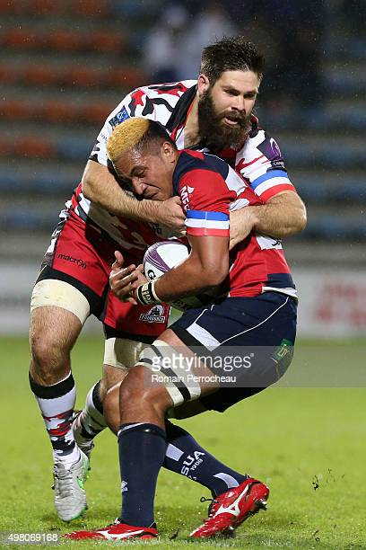 Sione Tau for Agen is tackled by Cornell Du Preez during the European Rugby Challenge Cup match between Agen and Edimbourg at Stade Armandie on...