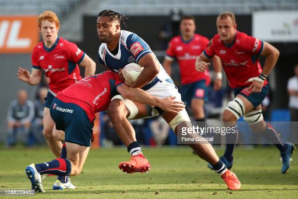 Sione Tuipulotu of Auckland drives through a tackle during the Mitre 10 Cup Final between Auckland and Tasman at Eden Park on November 28, 2020 in...