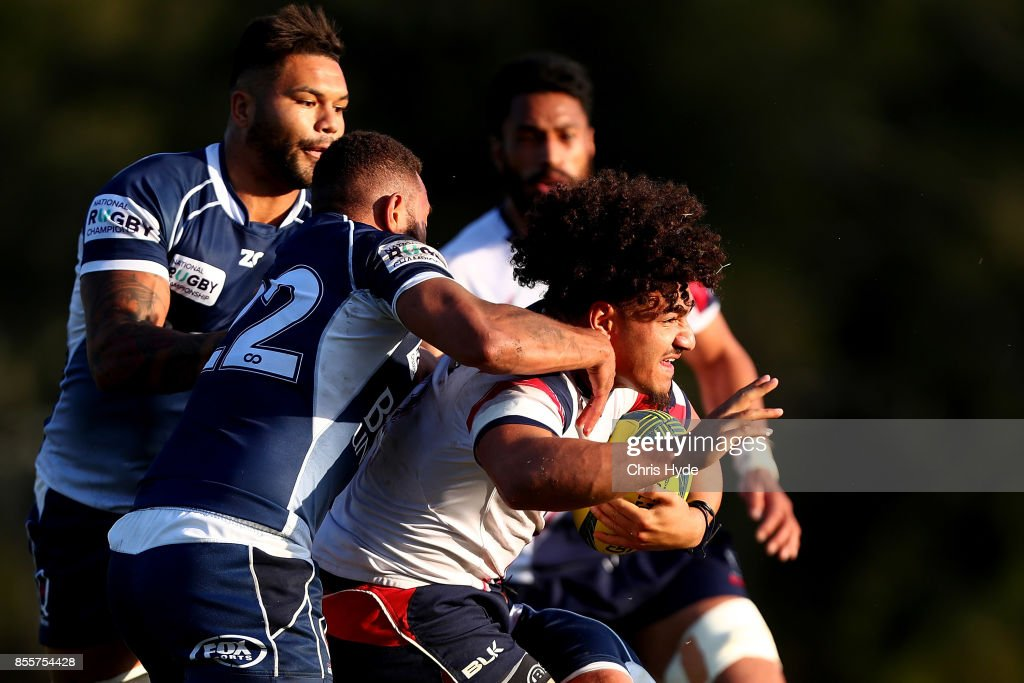 Sione Tuipulotu of Melbourne Rising is tackled during the round five NRC match between Queensland Country and Melbourne at Bond University on September 30, 2017 in Brisbane, Australia.