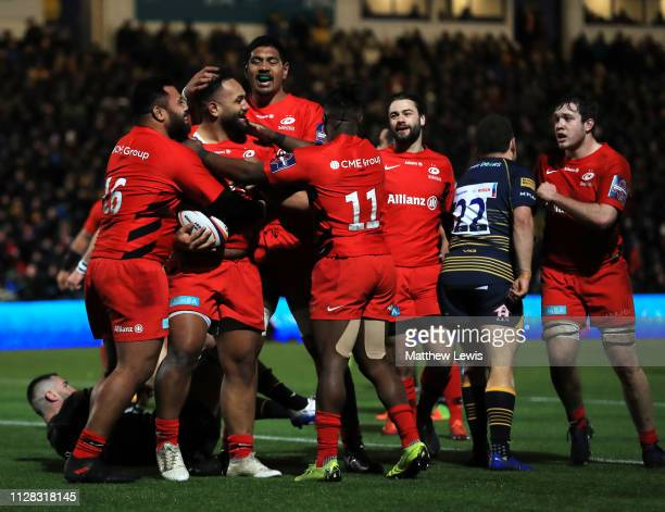Sione Vailanu of Saracens celebrates with team mates as he scores their fourth try during the Premiership Rugby Cup semifinal match between Worcester...