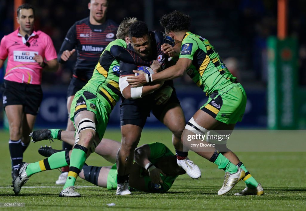 Sione Vailanu of Saracens tackled by Jamie Gibson (l) and Lewis Ludlam of Northampton Saints during the European Rugby Champions Cup match between Saracens and Northampton Saints at Allianz Park on January 20, 2018 in Barnet, England.
