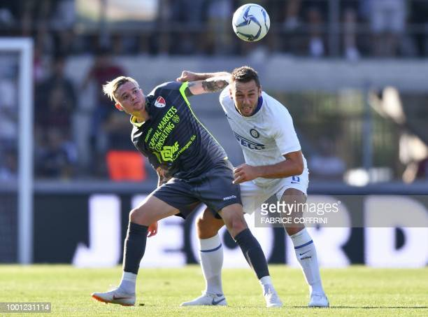 Sion's Brazilian midfielder Adryan and Inter Milan's Dutch defender Stefan de Vrij vie for the ball during the friendly football match between FC...
